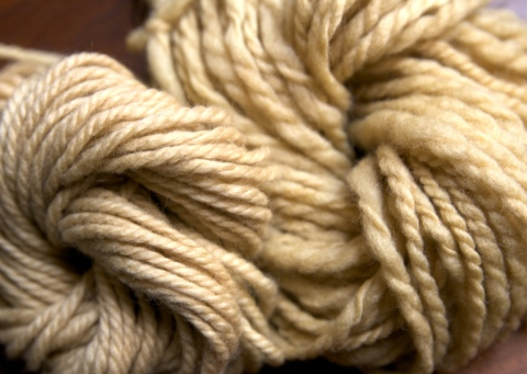 L to R: Commercial yarn and handspun Merino fleece